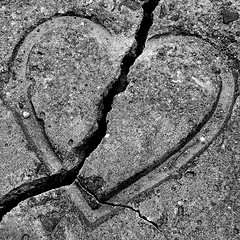 grey-cement-heart-broken